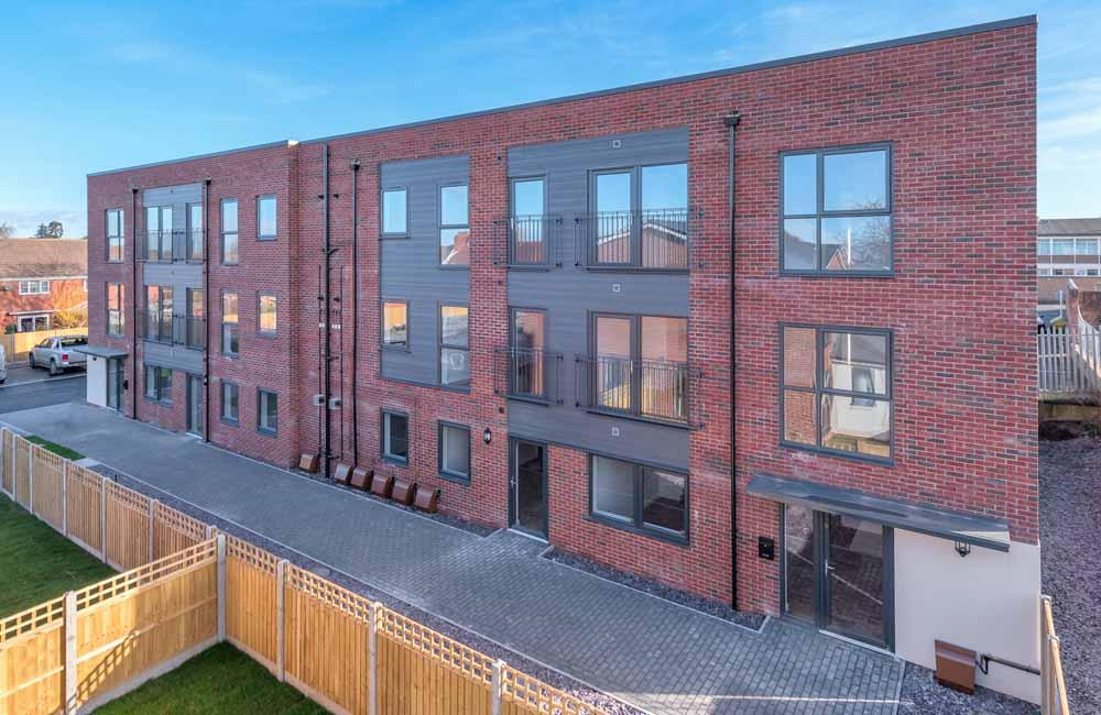 Red brick apartment building by TC Homes, Shrewsbury, Shropshire