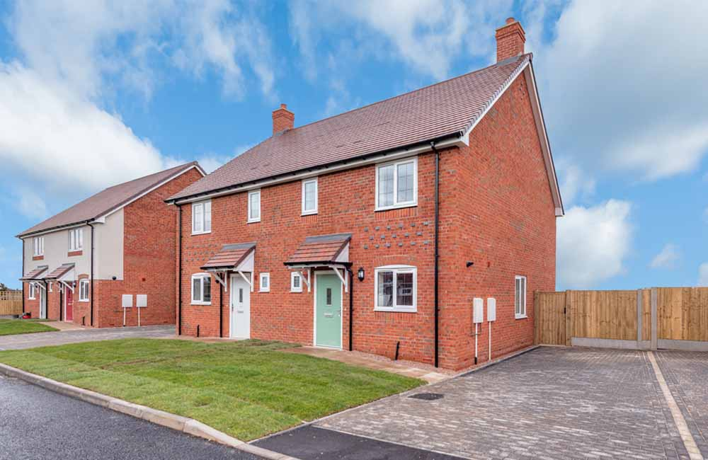 Red brick semi-detached house by TC Homes